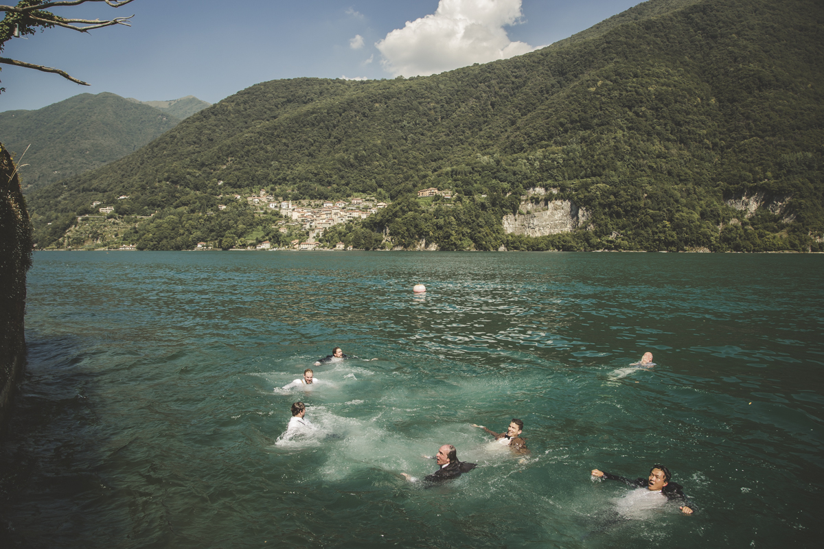 Wedding guests swimming in Como Lake