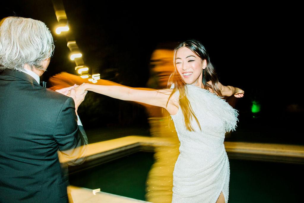 Bride having fun - Wedding at Villa La Foce - Italian Wedding Designer