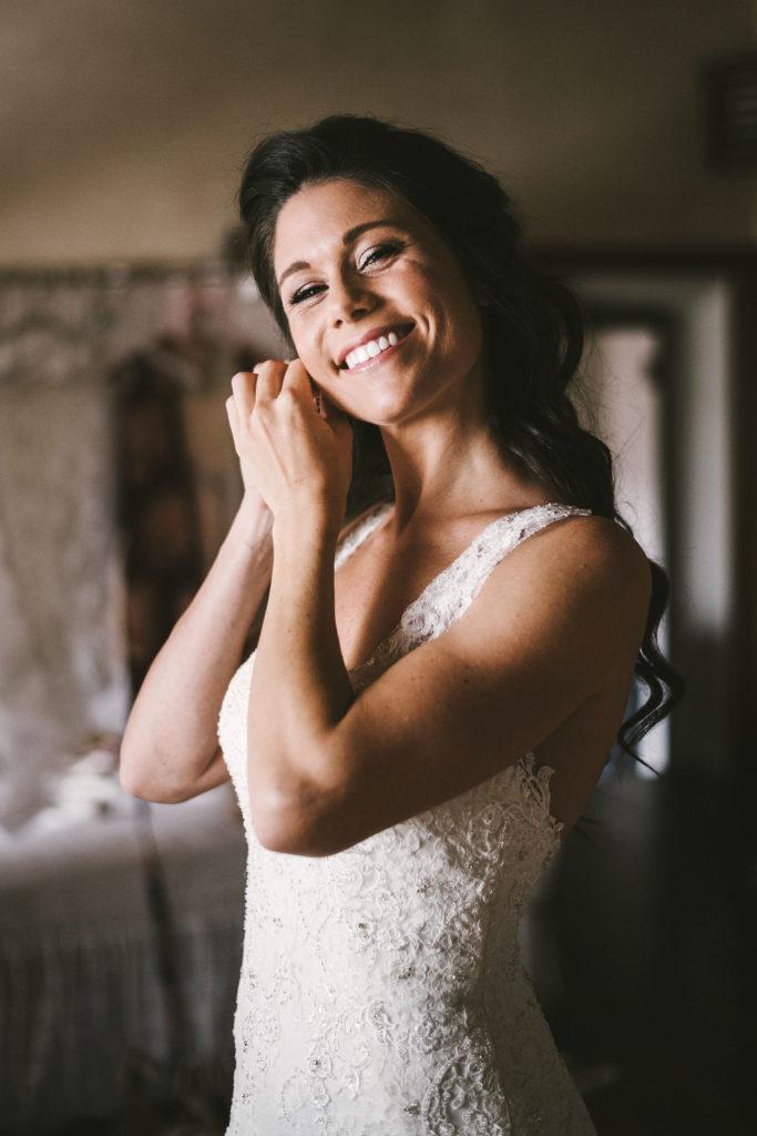 Bride getting ready Manolo Blahnik shoes - Wedding at Villa La Selva - Italian Wedding Designer