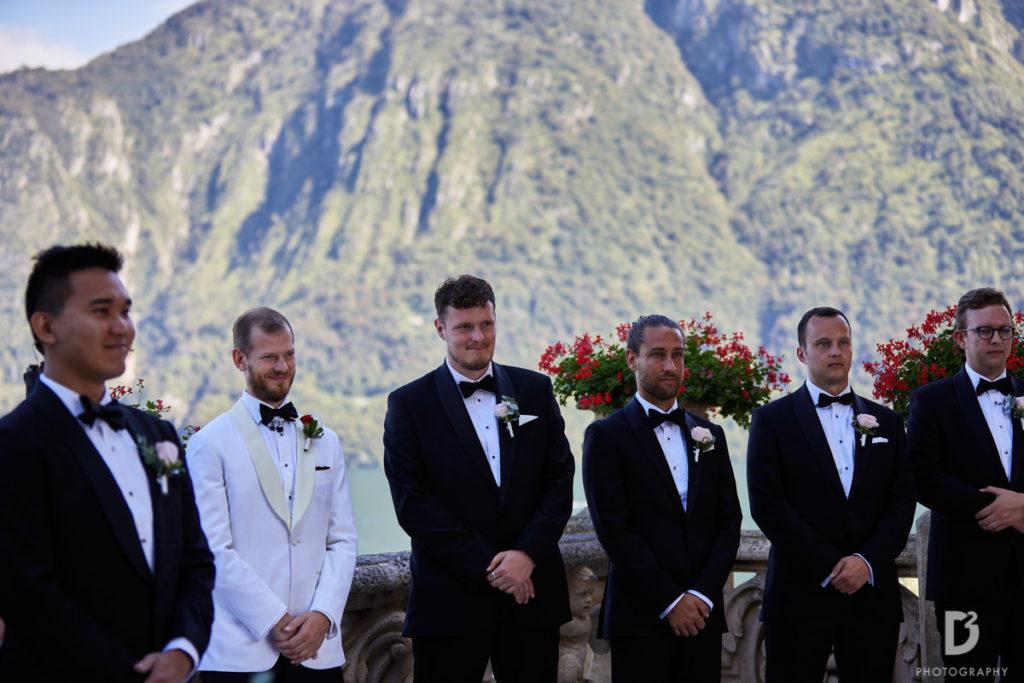 Groom and best men waiting bride