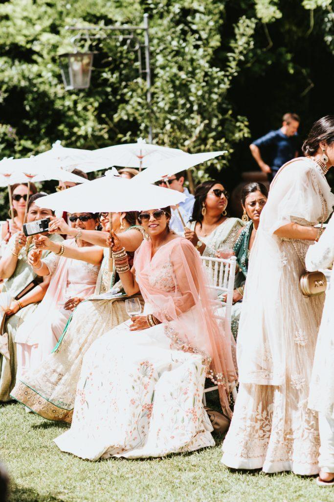 Guests with Sun Umbrellas - Hindu wedding at Hotel Caruso in Ravello - Italian Wedding Designer